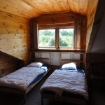 Slaapkamer in Log home pension